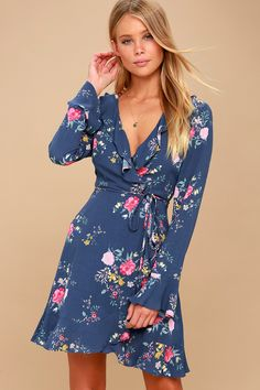 Lulus Exclusive! The Hello, Dahlia! Blue Floral Print Wrap Dress is fit for a starlet! Lightweight and gauzy fabric, adorned with blush, yellow, sage, and fuchsia floral print, forms a fluttery, ruffled V-neck, a dreamy darted, wrap bodice, and long flounce sleeves. Internal ties and a sash belt tie top a ruffled mini hem.