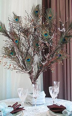 Google Image Result for http://weddingdisk.com/wp-content/plugins/jobber-import-articles/photos/124817-peacock-wedding-decorations.jpg