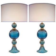 Le Blog: unique beauty of Murano glass doubles with this pair of gorgeous lamps in cerulean blue with flecks of 23k gold blown right into the glass.