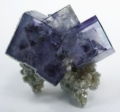 Fluorite Locality: Yaogangxian Mine, Yizhang County, Chenzhou Prefecture, Hunan Province, China Size: miniature, 3.3 x 3.1 x 2.1 cm Fluorite Exquisite cluster of SHARP, razor-sharp, transparent phantom crystals to 1.2 cm like a flower on muscovite matrix. NOT common quality, just a riveting little fluorite even from a mine that produced so many. Attribution: Rob Lavinsky. thingofinterest@pinterest