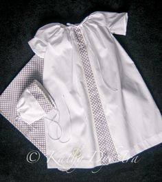 wee care gowns done by Kathy Dykstra with a good explanation on doing corded pintucks.*
