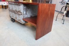 quartersawn mahogany top with shelf.  vintage lyon drawer unit with vintage cast iron dolly casters. www.facebook.com/rogue.decor