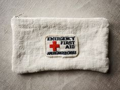 zipper pouch made from vintage European linen grain with American Red Cross patch – available at AtticAntics, $20.00