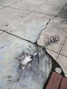 Sidewalk art - Wolf in quicksand being saved by mice