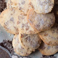 Pecan Sandies | These cookies are unbelievably light, delicate and crisp. The secret is to let the cookie dough chill overnight before slicing and baking.