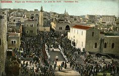 A postcard showing the Christmas Day procession to the Church of the Nativity, c. 1900.Bethlehem