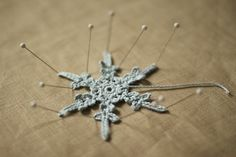 snowflake (crochet, likely)