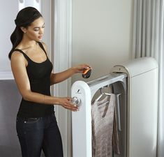 SWASH de-wrinkles and removes odors without the wear and tear of a traditional washing machine or dryer.