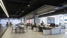 Havas Worldwide | Chicago Offices | Painted Exposed Ceiling / Dropped Ceiling Cloud / Linear Light Fixture / Benching / Glass Walls / Natural Light / Modern / Monochromatic