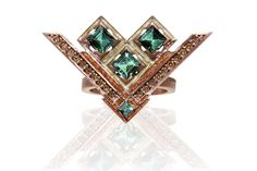Soul ring crafted from yellow gold plated with brown rhodium, two-toned enamel, brown diamonds and tourmaline, integrates the Latvian signs of Jumis, the three stars, Laima's broom and Mara's zigzag by Anita Sondore, Riga, Latvia.