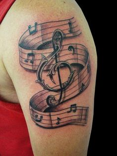 Big music symbol tattoo on arm