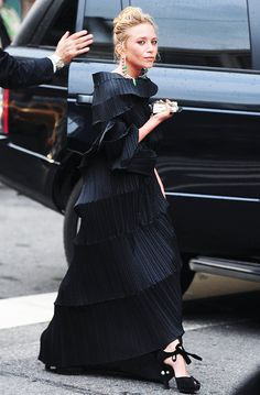 Mary-Kate Olsen wearing a black gown and black heels