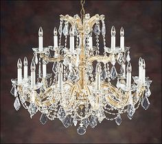 Eighteen-light Maria Theresa style crystal chandelier on an antiqued gilded wrought iron frame. Details on our website: DecorativeCrafts.com #decorativecrafts #decorative #lighting #lightfixture #chandelier #interiordesign #interiordecor #interior #lightfixtures #chandeliers #ceiling #homedesign #roomdesign #officedesign #elegant #chic #lavish #luxury #luxurious #crystal
