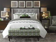 Strong black, white and green colour palette and gorgeous upholstered bed.