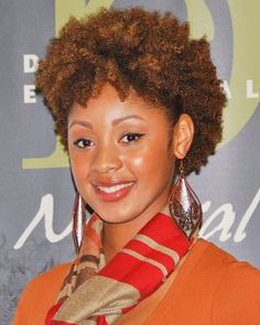 Design Essentials    Carmen Mitchell flaunts her natural hair with flair at the World Natural Hair Health & Beauty Show in College Park, GA.