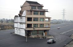 A house sits awkwardly in the middle of a newly built road in Wenling, Zhejiang province in China. An elderly couple refused to sign an agreement to allow their house to be demolished. In China, China Pics, China Today, Make Way, Construction, Property Development, Software Development, Wtf Fun Facts, Random Facts
