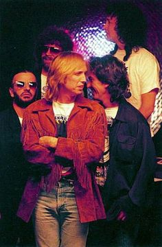 Traveling Wilburys~ Tom Petty forward, George Harrison right and Ringo Starr, left, visiting on drums, may hap?
