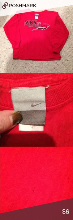 Nike football shirt size 4 In great condition except for a tiny pin size hole as shown in last photo. Nike Shirts & Tops Tees - Long Sleeve