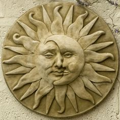 Garden plaque sun moon face by Oxo Cube, via Flickr