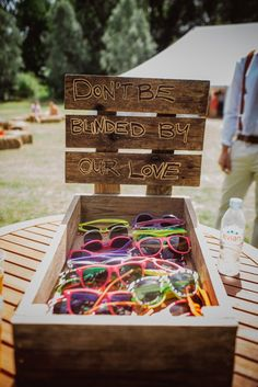 Rustic, Outdoor Summer Festival Wedding. Sunglasses to help yourself too in a rustic wooden box. Fab DIY that adds a thoughtful Festival vibe!