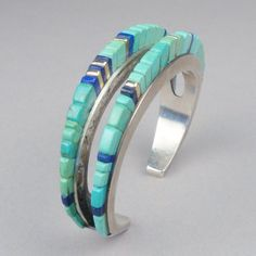 Vintage Charles Loloma sterling silver and 14k gold bracelet with turquoise and lapis lazuli height inlay c. 1975. Hopi Pueblo