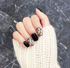 Black white and gold geometric nail design short gel star