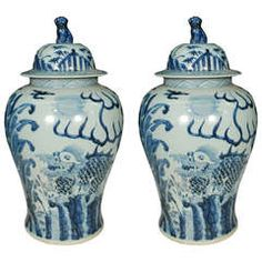 Pair of Chinese Blue and White Covered Jars with Qilin