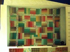 1st quilt.  (Fence rail) the flower fab. Was my daughters shower curtain.