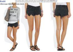 heavily destroyed black denim shorts