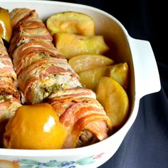 Pork tenderloins are rubbed with a lemon-sage paste, wrapped in bacon, then roasted with fresh apples in this delectable fall recipe. Bacon Wrapped Pork Tenderloin, Pork Tenderloin Recipes, Pork Roast, Pork Chops, Beef Tenderloin, Lemon Recipes, Pork Recipes, Cooking Recipes, Kitchens