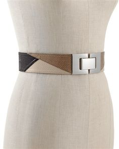 "COLORBLOCK SNAKE-EMBOSSED BELT  STYLE: 570054708  Overall Rating   5 / 5  read all 9 reviews  write a review  Neutrals are sharply defined on this wide belt with a bold, geometric buckle in silvertone metal. Hook closure; stretch elastic back. 2"" wide. Man-made leather/leather-lined. Imported.  Available Colors (click to view):  $48.00"
