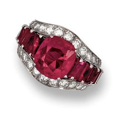 RUBY AND DIAMOND RING.   Set with a cushion-shaped ruby weighing 3.73 carats, between two lines of single- and brilliant-cut diamonds, the shoulders highlighted by calibré-cut rubies, mounted in platinum