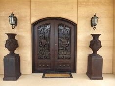 arched doors in rammed earth walls