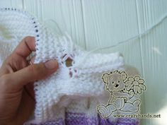 Check out my pattern of baby knit romper that was made in a gradient of puple and white yarn, has cool hood, and a fluffy fur pom. Knitted Cape Pattern, Baby Booties Knitting Pattern, Knitted Doll Patterns, Knitted Dolls, Baby Knitting Patterns, Hand Knitting, Knitting Stitches, Knitted Baby Outfits, Knitted Baby Clothes