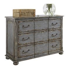 Distressed wood chest with three drawers and antiqued pewter hardware. Top drawer is felt lined.     Product: Chest  Cons...