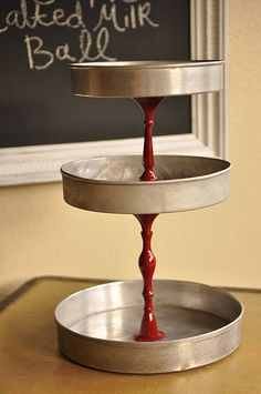 Tiered Stand from cake pans and old candlesticks spray painted.  From Your Homebased Mom Blog.