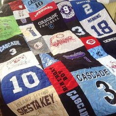 Another awesome T-shirt quilt full of jerseys & shorts that I couldn't show until after Christmas! #tshirtQuilt #tshirtQuilts #tshirtMemoryQuilt #sportsQuilt #soccer #shirtQuilt #basketball #football #baseball