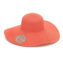 Our Orange Coral floppy sun hat is monogrammed with your initials for the big event!