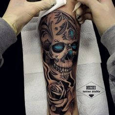 Elegant Gems Inlaid Skull tattoo by Vladimir Drozdov