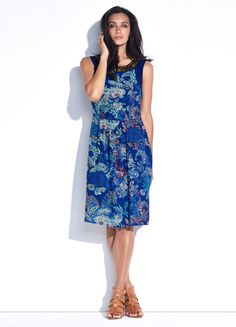 Karmien Printed Shift Dress. This sleeveless soft dress has a highlight beaded neckline and contrast fabric shoulder yoke panels. It also features our exclusive summer paisley print.