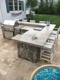 Outdoor kitchen on travertine patio Covered Outdoor Kitchens, Outdoor Kitchen Patio, Outdoor Kitchen Design, Outdoor Countertop, Large Backyard Landscaping, Backyard Patio Designs, Nice Backyard, Patio Ideas, Outdoor Grill Station
