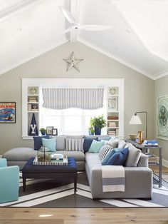 gray, navy, turquoise color scheme in the family room