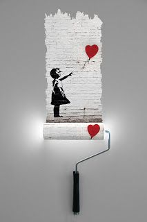 Banksy paint roller wall lamp - by Natalie Sampson