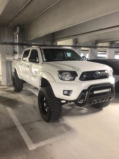"""My 2014 Tacoma   Rough Country 6 inch lift kit   35"""" Toyo open country tires   20x12.50 Moto Metal rims with white inserts   20"""" led bar mounted on bull bar   Black headlight mod   Color Matched grille   tint all around   Plasti dipped emblems   Pioneer 1600 watt amp   Two 12"""" Pioneer IB Flats   1000 watt 4 channel Pioneer Amp   Hertz door speakers and tweeters   All Lights replaced with Led's   Matte black low profile toolbox  """