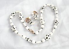 Vintage Black and White Polka Dot Necklace Earring Set Glass Beads Rockabilly. $32.50, via Etsy.