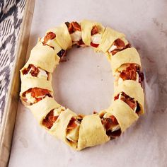 This bacon brie crescent wreath will be the star of your holiday party. Get the recipe at Delish.com. #delish #easy #recipe #christmas #holiday #Party #appetizer #fingerfoods #bacon #brie #crescent #pillsbury #foracrowd #video