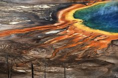 2016 National Geographic Travel Photographer of the Year | National Geographic colorful land Photo and caption by Xiaoliang Liu    The fountain in the Yellowstone National Park contains minerals, so the water is stained with color.