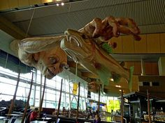 Visitors to the Wellington Airport can now dine beneath the hungry eyes of Gollum. In honor of the upcoming Hobbit movie, the Weta Workshop has installed a sculpture of the Ring-obsessed creature reaching for some tasty New Zealand rainbow trout.