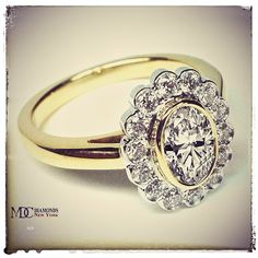 Oval Diamond Bezel Halo Engagement Ring in 14K Yellow Gold