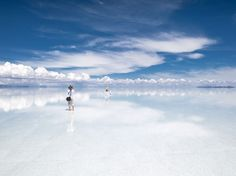Uyuni Salt Flat, Bolivia Photograph by Heiko Meyer, laif/Redux  Earth and sky are indistinguishable on the Salar de Uyuni, a vast salt flat in southwest Bolivia. A great lake covered this area 16,000 years ago. When it dried up, it left a 4,000-square-mile basin of salt, the world's largest such deposit. It's also one of Earth's flattest places—relief varies by less than 16 inches.